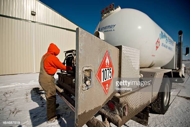 Nick Dykstra a liquid fuels technician with Michlig Energy Ltd prepares to fills a propane to a tank outside a township roadworks building near...