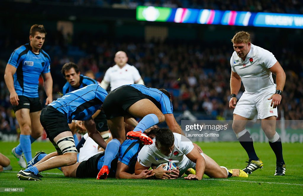 Nick Easter of England (R on ground) scores the third try during the 2015 Rugby World Cup Pool A match between England and Uruguay at Manchester City Stadium on October 10, 2015 in Manchester, United Kingdom.