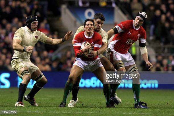 Nick Easter of England tackles James Hook of Wales during the RBS 6 Nations Championship match between England and Wales at Twickenham Stadium on...