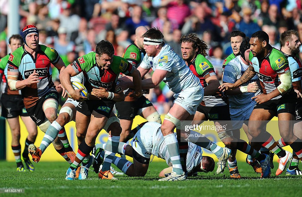 Nick Easter of Harlequins is tackled by Nic Rouse of London Irish during the Aviva Premiership match between Harlequins and London Irish at Twickenham Stoop on March 29, 2014 in London, England.