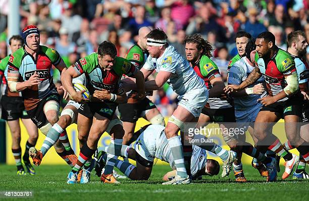 Nick Easter of Harlequins is tackled by Nic Rouse of London Irish during the Aviva Premiership match between Harlequins and London Irish at...