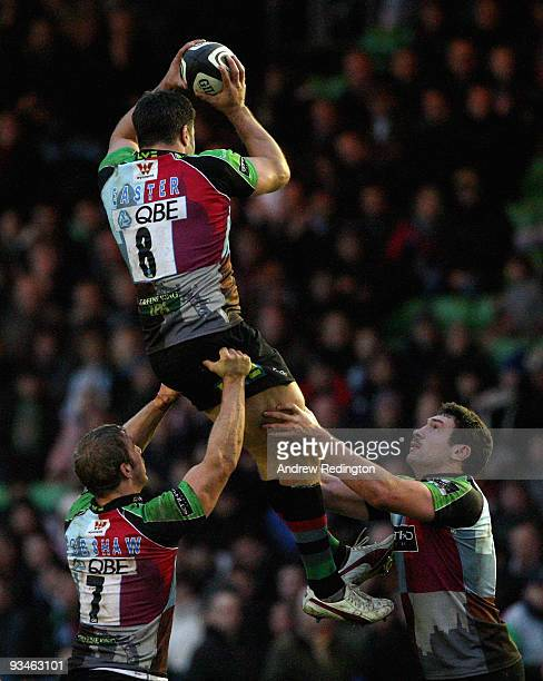 Nick Easter of Harlequins takes a lineout ball after being lifted by teammates Chris Robshaw and Tom Guest during the Guinness Premiership match...