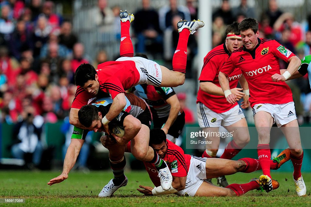 Nick Easter of Quins is hauled down by Conor Murray and Casey Laulala of Munster during the Heineken Cup quarter final match between Harlequins and Munster at The Twickenham Stoop on April 7, 2013 in London, England.