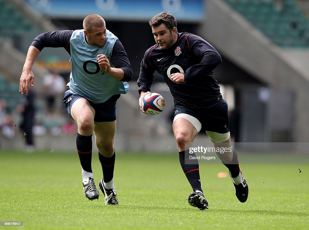 Nick Easter races away from Dave Attwood during an England training session held at Twickenham on May 18, 2010 in Twickenham, England.