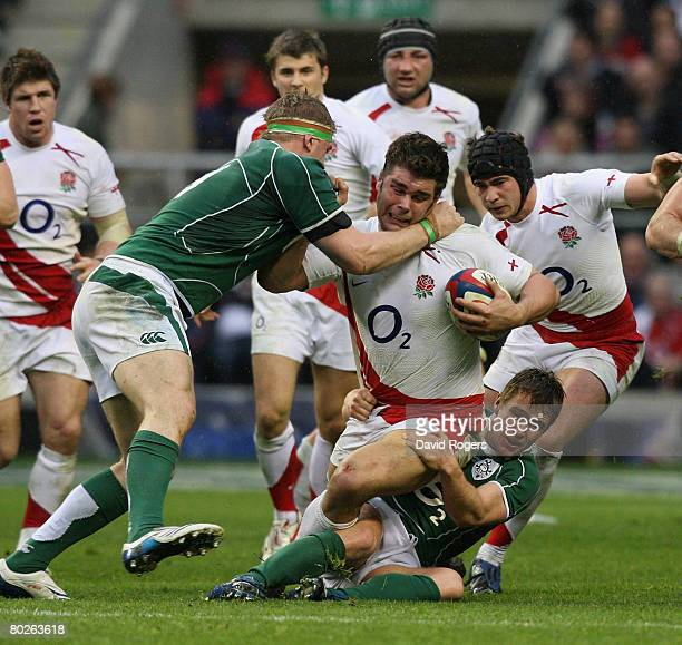 Nick Easter the England number 8 is tackled by Eoin Reddan and Mick O'Driscoll during the RBS Six Nations match between England and Ireland at...