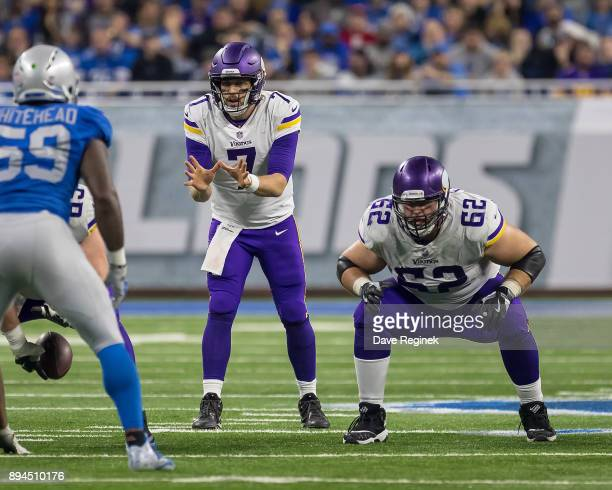 Nick Easton and Case Keenum of the Minnesota Vikings gets set for the play against the Detroit Lions during an NFL game at Ford Field on November 23...