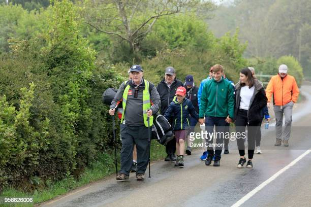 Nick Edmund of England a two time cancer survivor is followed by a group of family and friends during the final day's walk of his 'GlobalGolf4Cancer'...