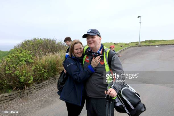 Nick Edmund of England a two time cancer survivor poses with his wife Teresa Edmund after passing the entrance to the Old Head Golf Links at the end...