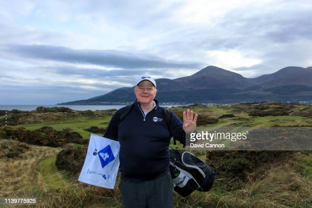 Nick Edmund of England poses for a photograph at the conclusion of his walk on the tee on the par 3 fourth hole at Newcastle Co Down Golf Club during...