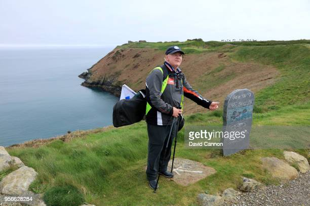 Nick Edmund of England stands beside a stone on the 13th hole during the final day's walk of his 'GlobalGolf4Cancer' walk along the Wild Atlantic Way...