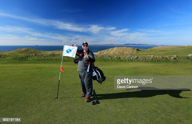 Nick Edmund of England stands beside the special flag on the fourth hole at Tralee Golf Club on another leg of his 2000km walk for his charity...