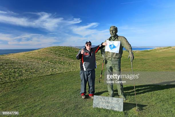 Nick Edmund of England stands beside the statue of 'The King' Arnold Palmer the designer of Tralee Golf Club as he completed another leg of his...