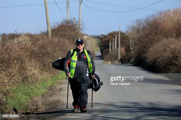 Nick Edmund of England walks towards Tralee Golf Club on another leg of his 2000km walk for his charity 'Global Golf4Cancer' playing the fourth hole...