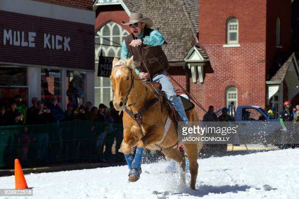 Nick Ehlenfeldt races down Harrison Avenue on his horse Smarty while pulling skier Britany Leafe during the 70th annual Leadville Ski Joring weekend...