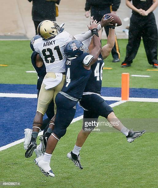 Nick Elder and Alex Lyons of the Rice Owls knock the ball away from Jeff Ejekam of the Army Black Knights on the final play of the game at Rice...