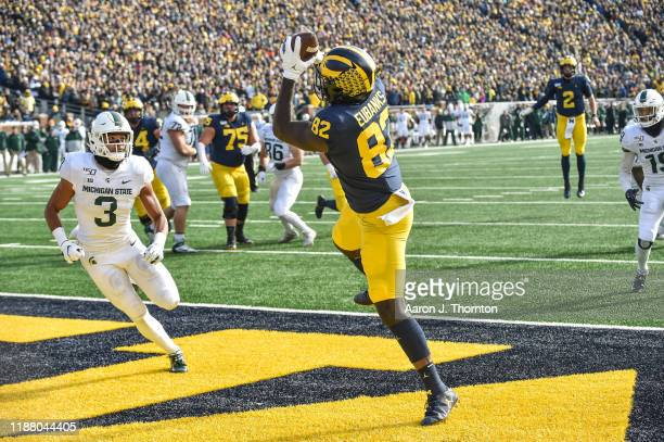 Nick Eubanks of the Michigan Wolverines catches a pass for a touchdown during the first half of a college football game against the Michigan State...