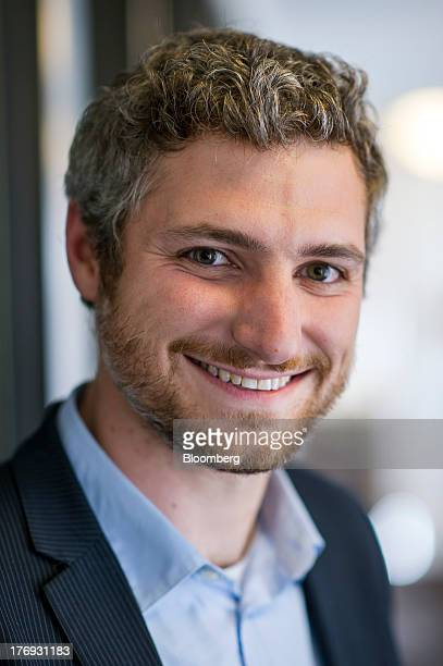 Nick Evans Cofounder Of Reveal Labs And Chief Executive Officer Tile Stands For A Photograph
