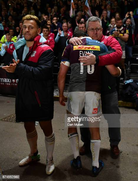 Nick Evans of Harlequins embraces John Kingston Harlequins Director of Rugby following his final home appearance during the Aviva Premiership match...