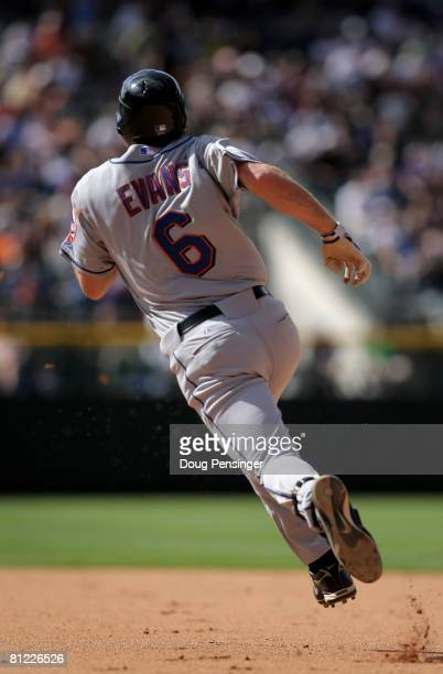 Nick Evans of the New York Mets heads to second with an RBI double against the Colorado Rockies to give the Mets a 7-2 lead in the eighth inning at...