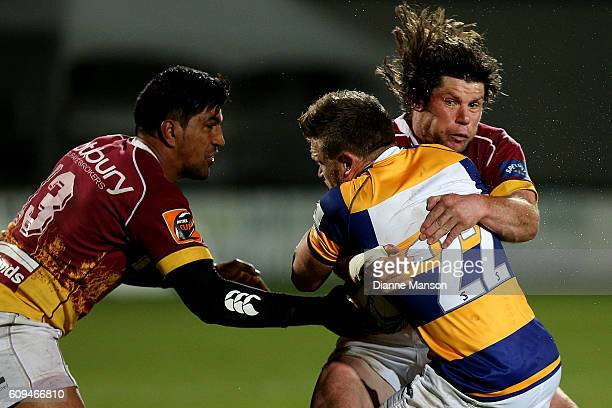 Nick Evemy of Bay of Plenty in the tackle of Tim Boys and Dyland Collier of Southland during the Mitre 10 Cup round 6 match between Southland and Bay...