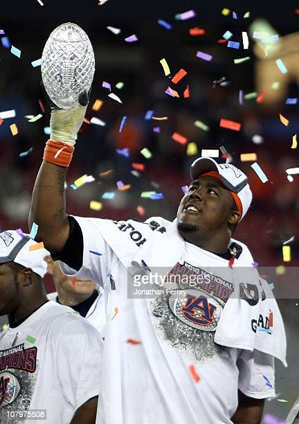 Nick Fairley of the Auburn Tigers celebrates the Tigers 22-19 victory against the Oregon Ducks during the Tostitos BCS National Championship Game at...