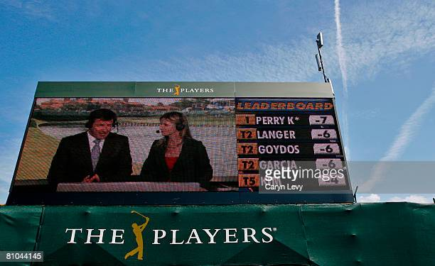 Nick Faldo and Kelly Tilghman appear live on the Mitsubishi electronic scoreboard during the second round of THE PLAYERS Championship on THE PLAYERS...
