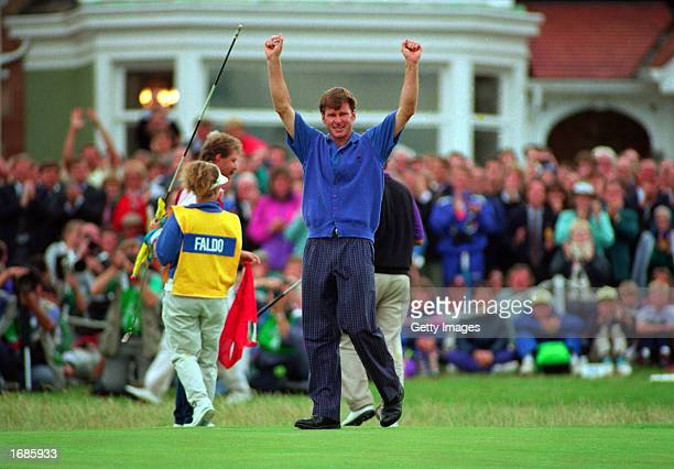 Nick Faldo celebrates putting the winner at the Brittsh Open on Muirfield golf course in Scotland in the 1992 British Open