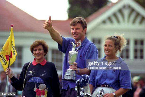 Nick Faldo his wife Gill and caddie Fanny Sunesson salute adoring fans at the 18th after Faldo won the 121st Open Golf Championship at Muirfield in...