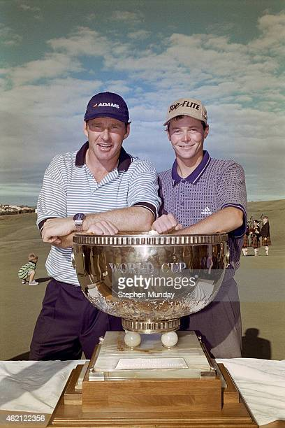 Nick Faldo of England and David Carter of England with the team trophy at Gulf Harbor CC on November 22, 1998 in Auckland, New Zealand.