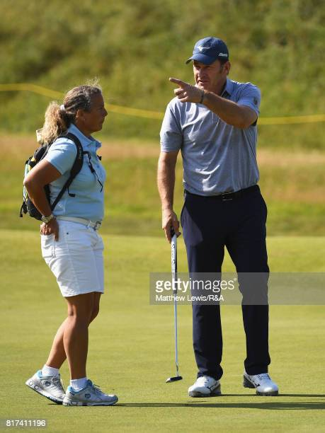 Nick Faldo of England chats to his former caddie Fanny Sunesson during a practice round prior to the 146th Open Championship at Royal Birkdale on...