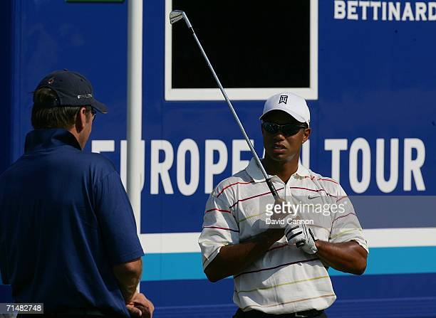 Nick Faldo of England chats with Tiger Woods of USA on the range during final practice for The Open Championship at Royal Liverpool Golf Club on July...