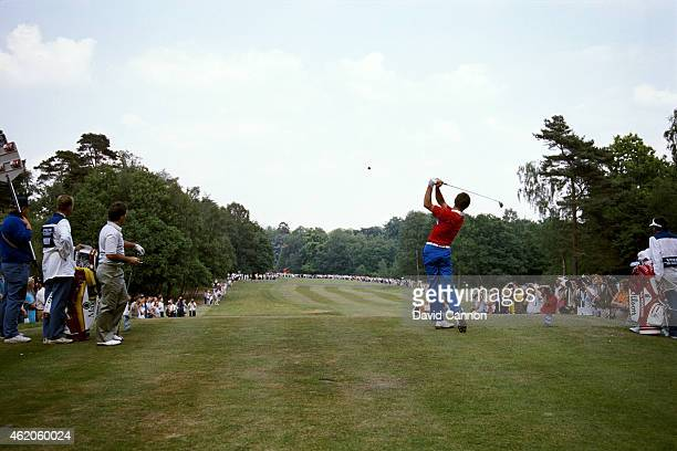 Nick Faldo of England drives from the 17th tee watched by Craig Parry of Australia during the 1989 Volvo PGA Championship on the West Course at...