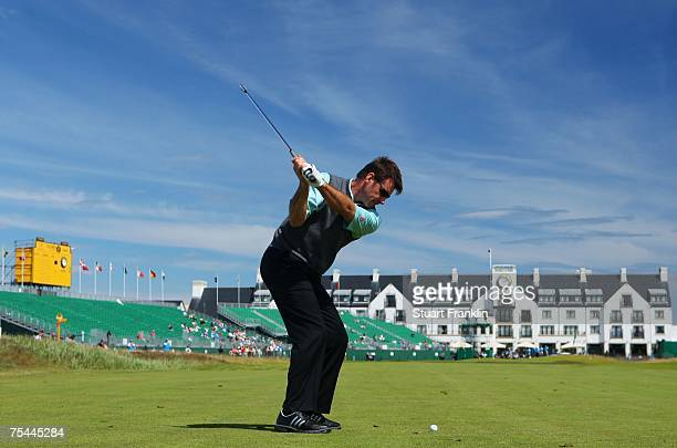Nick Faldo of England hits his approach shot on the 18th hole in his practice round during previews to The 136th Open Championship at the Carnoustie...