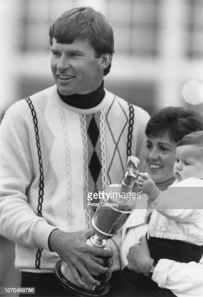 Nick Faldo of England holds The Claret Jug Gill Faldo and son Matthew after his victory during the final round in the 116th Open Championship played...