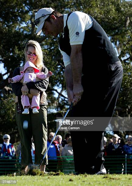 Nick Faldo of England is watched on the practice range by his wife Valerie and new baby daughter Emma during final practice for the UBS Cup on the...