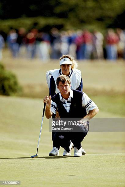 Nick Faldo of England lines up a putt on the fourth green with the help of his caddie Fanny Sunesson of Sweden in teh final round during the 119th...