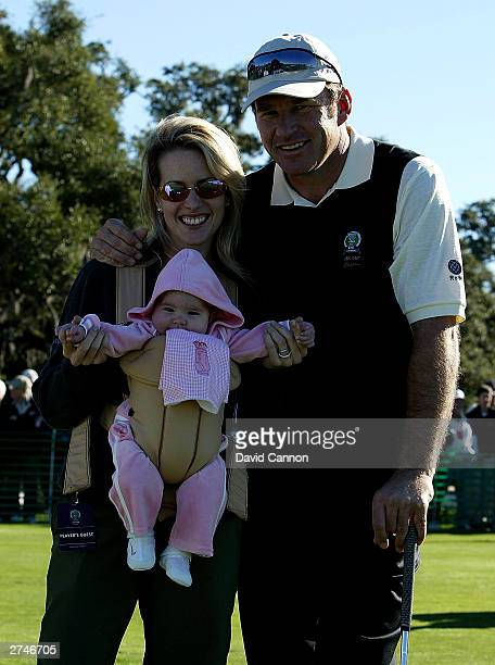 Nick Faldo of England on the practice range with his wife Valerie and new baby daughter Emma during final practice for the UBS Cup on the Seaside...