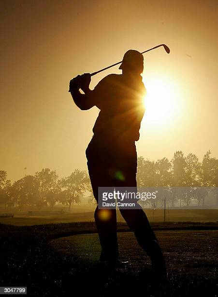 Nick Faldo of England on the range during the fog delay before the completion of the 2nd round of the Dubai Desert Classic on the Majilis Course at...