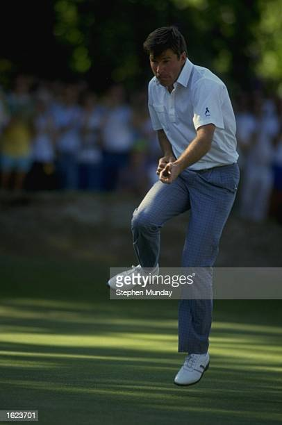 Nick Faldo of England plays air guitar on the final day of the PGA Championships at Wentworth in Surrey England Mandatory Credit Stephen...