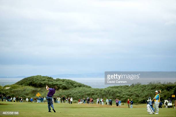 Nick Faldo of England plays his second shot at the par 4 15th hole watched by his caddie Fanny Sunesson of Sweden during the 121st Open Championship...