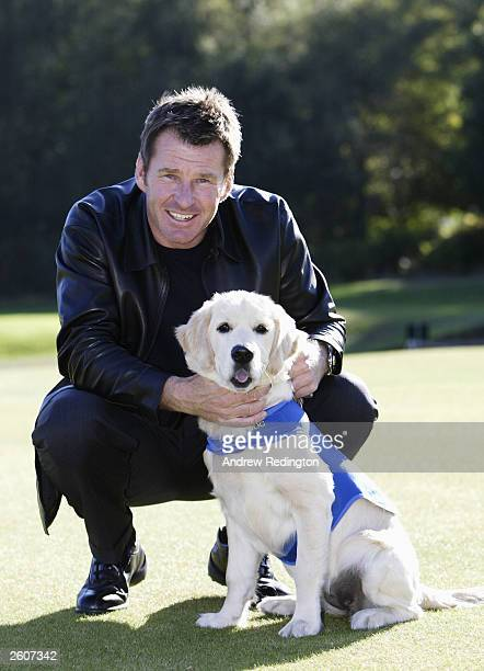 Nick Faldo of England poses with a guide dog during a photocall to promote his partnership with The Guide Dogs for the Blind at the HSBC World Match...