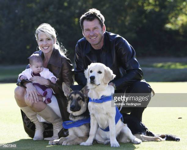 Nick Faldo of England poses with his wife Valerie and their sixweek old daughter Emma and two guide dogs during a photocall to promote his...
