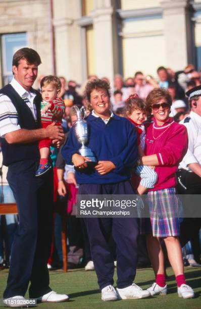 Nick Faldo of England poses with wife Gill Faldo and caddie Fanny Suneson after his victory during The 119th Open Championship held on the Old Course...