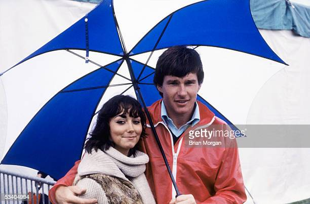Nick Faldo of England poses with wife Melanie