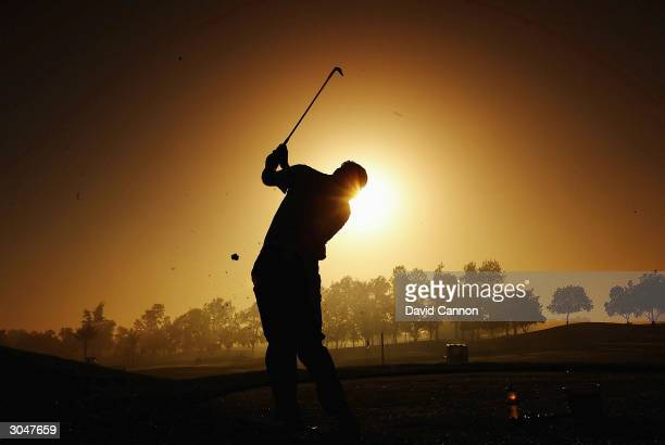 Nick Faldo of England practices on the range during the fog delay before the completion of the 2nd round of the Dubai Desert Classic on the Majilis...