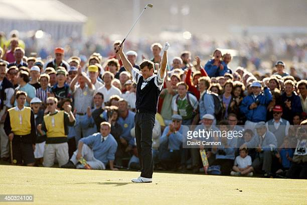 Nick Faldo of England raises his arms after his second shot to the 18th green on the way to his win in the 119th Open Championship played on the Old...