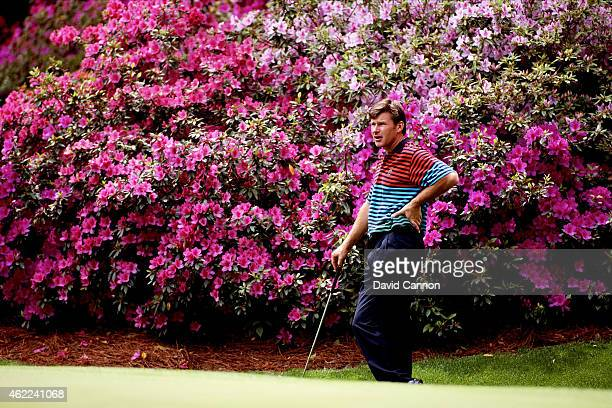 Nick Faldo of England receives putting instruction from his coach David Leadbetter as his caddie Fanny Sunesson of Sweden looks on in the Masters...