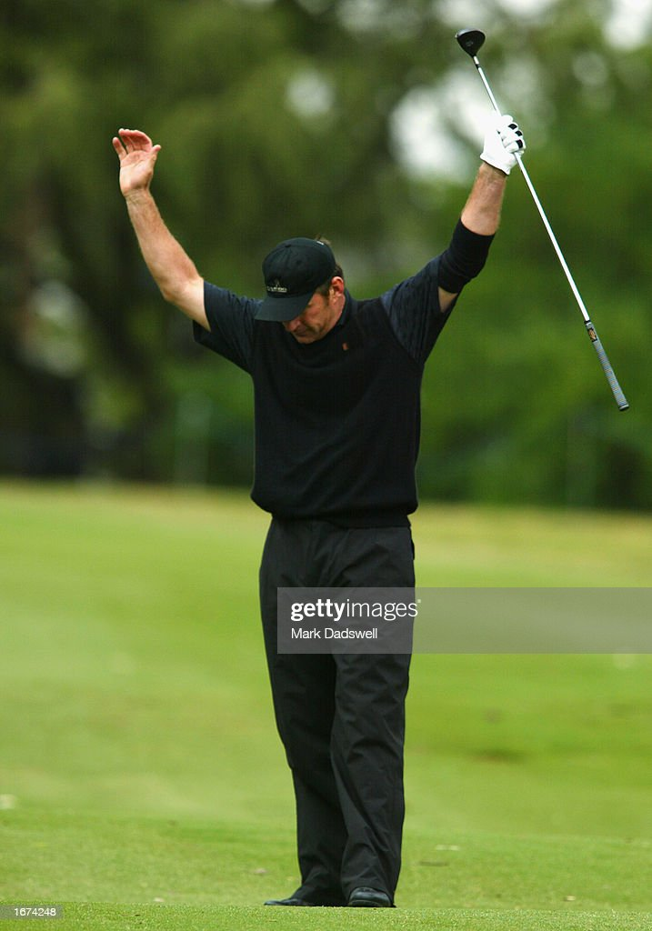 Nick Faldo of England shows his delight with his second shot on the eighth hole during the first round of the Ericcson Masters Golf held at the Huntingdale Golf Club in Melbourne, Australia on December 5th, 2002. (Picture by Mark Dadswell/Getty Images).
