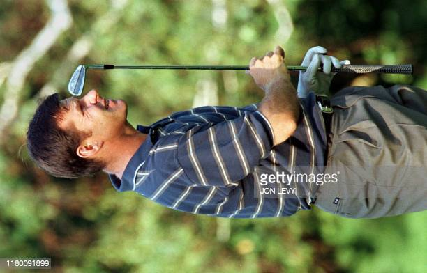 Nick Faldo of England watches his shot on the first hole 14 August during the opening round of the PGA Championships at Winged Foot Golf Club in...