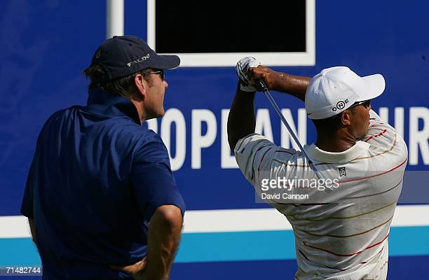 Nick Faldo of England watches Tiger Woods of USA on the range during final practice for The Open Championship at Royal Liverpool Golf Club on July 19...